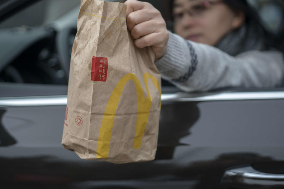TIANJIN, CHINA - 2018/03/20: A customer bought food from a McDonald's Drive-Thru restaurant. McDonald's has added a 'Food Safety Quality Commission' in China at the end of 2017, and announced that it would open about 2000 new McDonald's restaurants in mainland China in the next five years. (Photo by Zhang Peng/LightRocket via Getty Images)
