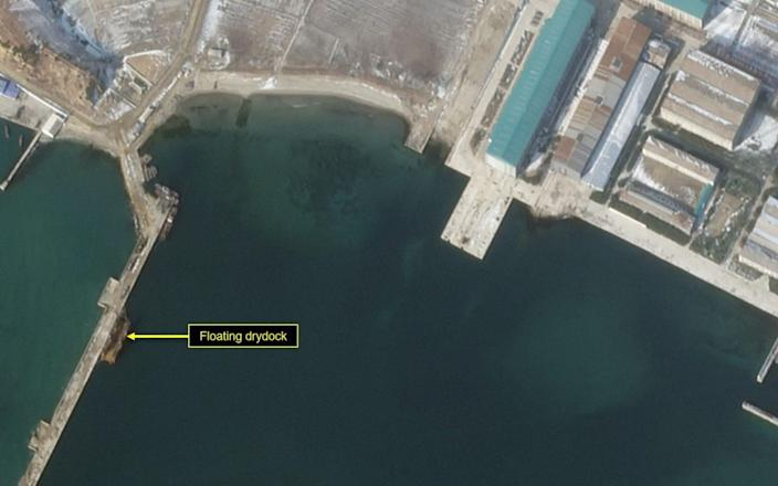 A floating dry dock has been positioned alongside the launch quay - Planet Labs
