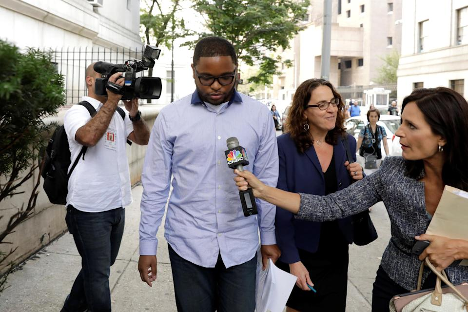 Christian Dawkins, a former ASM employee, exits the Manhattan Federal Courthouse, after being arrested for bribery and fraud in connection with college basketball recruiting. (Reuters)