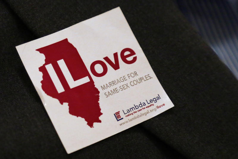 FILE - In this Jan. 3, 2013 file photo, a supporter for same sex-marriage wears a sticker on her jacket before attending a Senate Executive committee hearing at the Illinois State Capitol in Springfield, Ill. The Illinois Senate is expected to vote on the bill to end Illinois' ban on same-sex marriage Thursday, Feb. 14, 2013. (AP Photo/Seth Perlman, File)