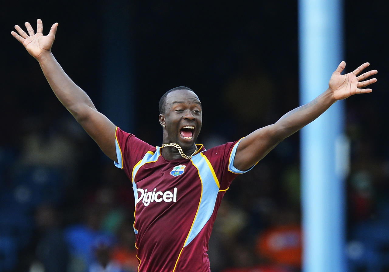 West Indies bowler Kemar Roach celebrates dismissing Sri Lankan batsman Mahela Jayawardene during the fifth match of the Tri-Nation series between Sri Lanka and West Indies at the Queen's Park Oval in Port of Spain on July 7, 2013. West Indies won the toss and elected to field. AFP PHOTO/Jewel Samad