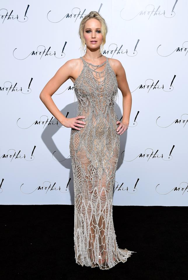 <p>J Law was particularly daring in London, choosing a sheer cobwebbed Atelier Versace gown.<br /><i>[Photo: PA]</i> </p>