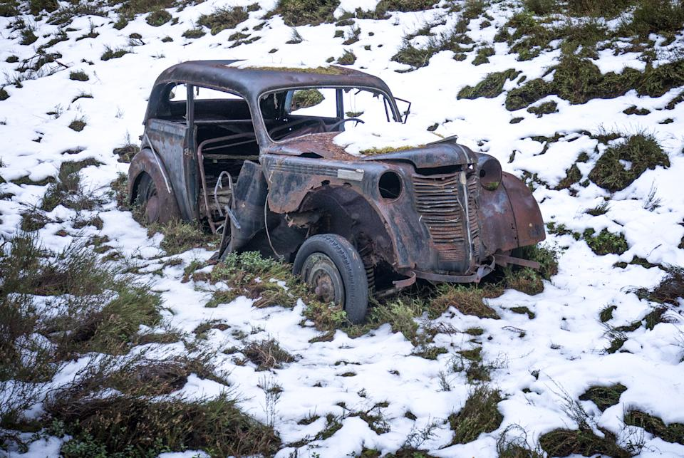 An abandoned vintage car sits surrounded by snow in the Cairngorms National Park in the Scottish Highlands. Picture date: Monday January 18, 2021. (Photo by Jane Barlow/PA Images via Getty Images)