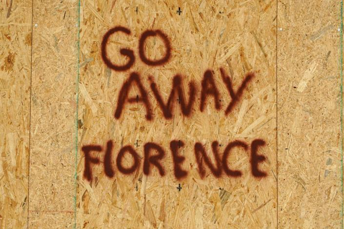 <p>A message is posted on a boarded up building before the arrival of Hurricane Florence on Oak Island, N.C., Sept. 12, 2018. (Photo: Carlo Allegri/Reuters) </p>