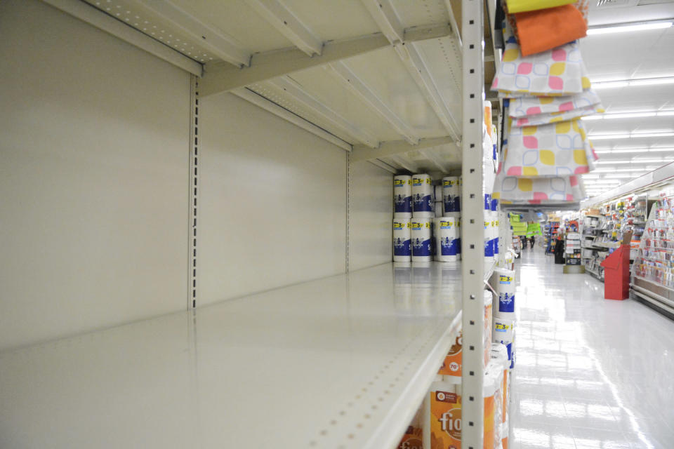 FILE - In this Monday, Nov. 2, 2020, file photo, a section of shelving that normally holds paper towels sits empty at Redner's in Schuylkill Haven, Pa., amid the latest surge of the coronavirus pandemic. (Lindsey Shuey/The Republican-Herald via AP)