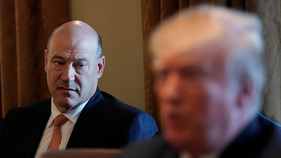 Outgoing economic adviser Gary Cohn (L) listens as U.S. President Donald Trump speaks during a cabinet meeting at the White House in Washington, U.S., March 8, 2018. REUTERS/Kevin Lamarque