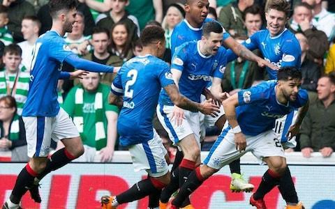 "The third Old Firm derby of the season proved to be a confirmation ceremony. We knew that Rangers had improved but that Celtic had more quality plus strength in depth and the champions duly remained top dogs after a convulsive contest at Ibrox, where they twice came from behind to edge a victory, despite being reduced to 10 men by the dismissal of Jozo Simunovic for a flying elbow on Alfredo Morelos. Celtic's Odsonne Edouard celebrates the winner Credit: PA The occasion was reminiscent – for those whose recall stretches back to 1979 – of the derby which saw Celtic clinch the title on their own turf with a 4-2 victory over Rangers, although they were a man down after Johnny Doyle was sent off. The current Rangers side will rue this setback deeply, aware that they had a totemic outcome within their grasp but lacked the guile and will to secure it. A bold stroke by Brendan Rodgers, with the game tied at 2-2, was rewarded with the dividend of a win that puts Celtic nine points clear of Rangers, with a game in hand and a significantly superior goal difference. He had staunched the gap left by Simunovic, who trudged off in the 57th minute, by sending on another central defender in Jack Hendry, with Tom Rogic making way. Midway through the second half, the Parkhead manager withdrew another attacking midfielder, James Forrest, but deployed Odsonne Edouard to partner Moussa Dembele. Josh Windass gave Rangers an early lead Credit: Getty Images Europe In a classic example of the vagaries of football fortune, Celtic's substitution might have been made to look like a failed gambler's throw within seconds of Edouard's appearance, when Morelos found himself one on one with Scott Bain. A truly predatory striker would have buried the chance and put Rangers back in front. Instead, the lack of menace that characterised Morelos' performance was highlighted when Bain made a crucial block. Moments later, at the other end of the field, Sean Goss allowed Edouard to get across him inside the box to despatch a delectable curled effort beyond Wes Foderingham for what proved to be the winner. Bain was entitled to celebrate as extravagantly as Edouard. The goalkeeper, a January signing, was Celtic's third choice for the position but, because of Craig Gordon's long-term injury and a training knock sustained by the deputy, Dorus de Vries, Bain was informed on the morning of the match that his Celtic debut would be in an Old Firm derby at Ibrox. His most recent prior start was on October 28, for Dundee. No pressure, then. The afternoon looked as though it might become notably painful for Bain when his first touch was to pick the ball out of his own net after only two minutes of play. The goalkeeper was not the villain of the piece, however. That label was applied to Dedryck Boyata, who allowed Josh Windass to ambush him on the halfway line for a sprint which finished with a fierce rising drive for the opening goal. Daniel Candeias (right) celebrates scoring his side's second goal Credit: PA Rangers led Celtic for the first time in five encounters and the home support responded with a paroxysm of relief and celebration. Their exultation was brief cut short by an equally forceful shot by Rogic from just beyond the edge of the box for the equaliser nine minutes later. The incident was doubly damaging for Rangers because the Australian's momentum carried him into a contact with David Bates and the Ibrox centre-back had to be stretchered off and replaced by Fabio Cardoso. Rangers, though, were ahead again in the 35th minute when Boyata allowed a cross from the left to bounce beyond him inside the box, a mistake duplicated by the usually flawless Kieran Tierney. The ball sat up perfectly for Daniel Candeias to find the mark and the stadium shook again to the exultations of the home support. An interval lead would have given Rangers a bridgehead for the subsequent action but in injury time they contributed to the catalogue of defensive errors when a hoofed clearance from Scott Brown dropped between the central pair of Cardoso and Bruno Alves for Dembele to lob over Foderingham and make it 2-2 at the break. The battle was subsequently won as much in the technical areas as on the pitch. Graeme Murty, albeit with a less potent substitutes' roster than Rodgers, persisted with Morelos long after the Colombian looked drained of self-belief, while Kenny Miller – a forward with priceless experience of this fixture – remained on the bench. Instead, Jason Cummings arrived to partner Morelos, who completed a miserable afternoon in the closing moments by striking the post from close range while Bain lay helpless on his line. Having squandered a chance to salvage even a draw from the proceedings, Rangers are now irretrievably adrift of their arch-foes as Celtic proceed towards the formality of a seventh successive Scottish title. 2:09PM That's all from us If Rangers were starting to talk up their title chances ahead of kick off, they will have to take a moment for quiet reflection after that result. Celtic did well after going a man down and, on balance, deserved their win. The Hoops are now nine points clear at the top of the table and nailed on to win the league. Super. Sub. �� #RANCELpic.twitter.com/f5s2ZqkZw2— Celtic Football Club (@CelticFC) March 11, 2018 2:06PM Kris Boyd on Edouard's winner ""From a Rangers point of view you've got to show him down the line,"" says Kris Boyd in the studio. ""It's a great finish but it's criminal defending."" 2:03PM Scott Brown on Celtic's win ""We knew in the second half we could dominate,"" says Scott Brown in his post-match interview. ""Sadly we lost a man but we stuck to our task and defended well overall."" ""They [Rangers] done a lot of talking beforehand and we stayed quiet. We do our talking on the park."" 1:56PM Joy for 10-man Celtic GLASGOW IS GREEN. �� Derby win for 10-men Celtic! #RANCELpic.twitter.com/xzJ9d0IyZY— Celtic Football Club (@CelticFC) March 11, 2018 1:55PM Disappointment for Rangers FULL TIME: Rangers 2-3 Celtic (Windass 3 Candeias 27 