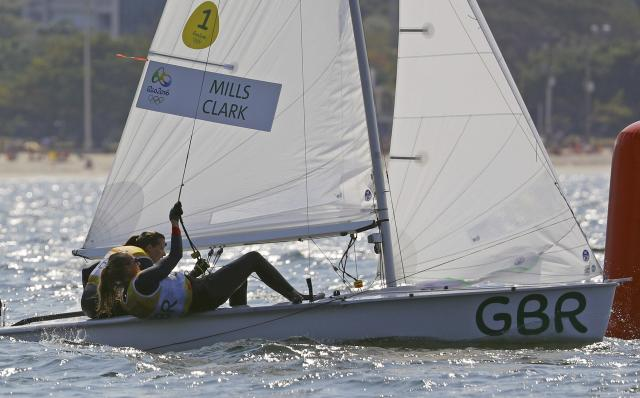 2016 Rio Olympics - Sailing - Final - Women's Two Person Dinghy - 470 - Medal Race - Marina de Gloria - Rio de Janeiro, Brazil - 18/08/2016. Hannah Mills (GBR) of Britain and Saskia Clark (GBR) of Britain compete. REUTERS/Brian Snyder FOR EDITORIAL USE ONLY. NOT FOR SALE FOR MARKETING OR ADVERTISING CAMPAIGNS.
