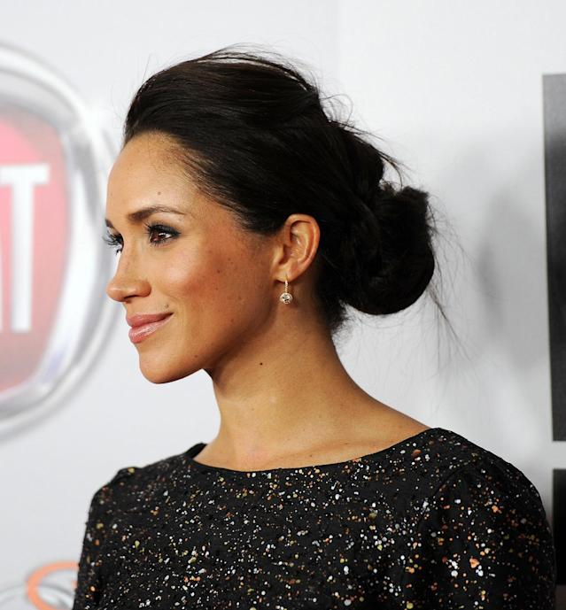 <p>Markle stole the show at NBC Universal's 70th Golden Globes after-party with a slightly tousled chignon. (Photo: Amanda Edwards/WireImage) </p>