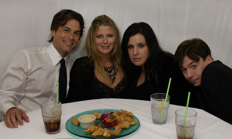Rob Lowe and his wife Sheryl, left, along with Mike Myers and his wife Robin pose for a photograph at the Entertainment Tonight Emmy Party in Los Angeles on Sunday, Sept. 21, 2003. (AP Photo/Laura Rauch)