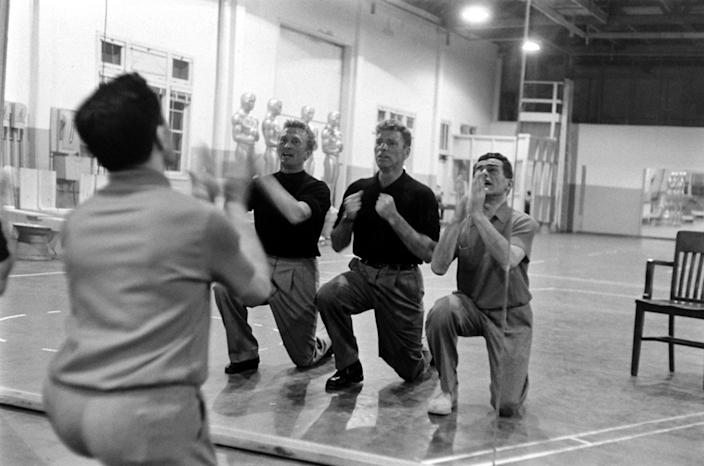 """Not published in LIFE. Kirk Douglas and Burt Lancaster with choreographer Jack Cole, practicing a mock-bitter song-and-dance number called """"It's Great Not to Be Nominated""""; the tune ribbed many of the year's Oscar contenders. (Leonard McCombe—TIME & LIFE Pictures/Getty Images) <br> <br> <a href=""""http://life.time.com/culture/oscars-rare-photos-from-academy-award-rehearsals-1958/#1"""" rel=""""nofollow noopener"""" target=""""_blank"""" data-ylk=""""slk:Click here to see the full collection at LIFE.com"""" class=""""link rapid-noclick-resp"""">Click here to see the full collection at LIFE.com</a>"""