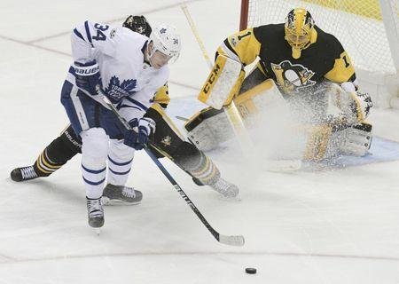 Dec 9, 2017; Pittsburgh, PA, USA; Toronto Maple Leafs center Auston Matthews (34) tries to get a shot off against Pittsburgh Penguins defenseman Olli Maatta (3) and goalie Casey DeSmith (1) during the second period at PPG PAINTS Arena. Mandatory Credit: Don Wright-USA TODAY Sports