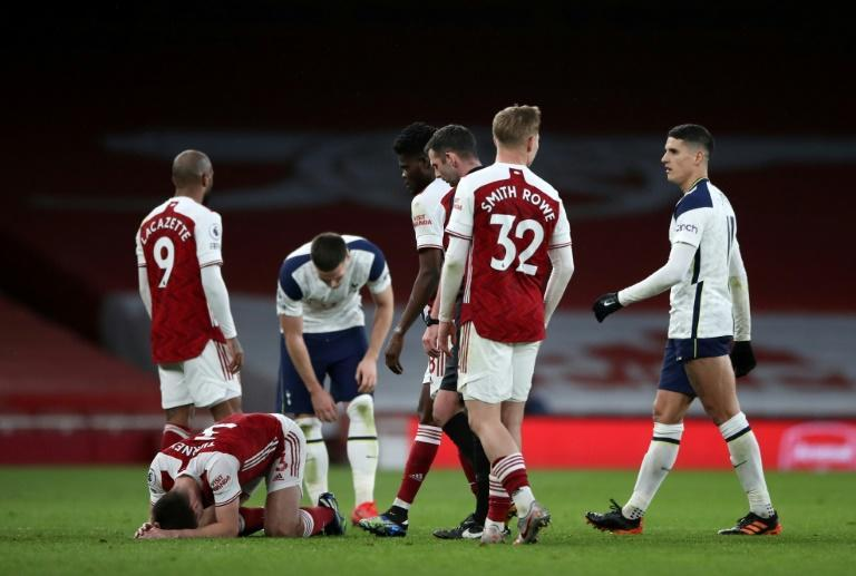 That's a red: Tottenham Hotspur's Argentinian midfielder Erik Lamela (right) is sent-off against Arsenal