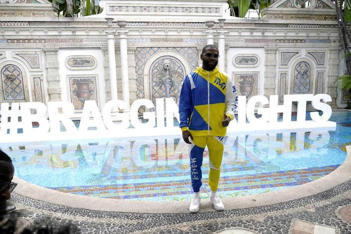 Floyd Mayweather poses for a photograph during a media event to promote his exhibition against Logan Paul.