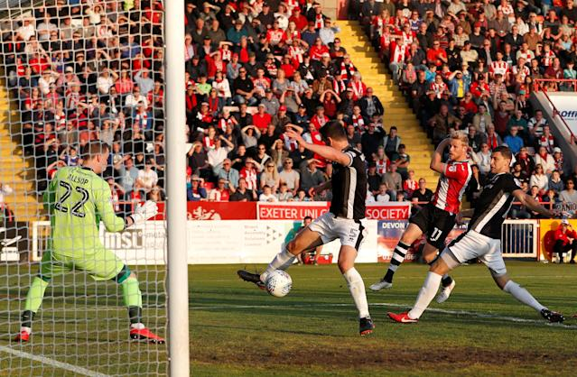 "Soccer Football - League Two Play Off Semi Final Second Leg - Exeter City vs Lincoln City - St James Park, Exeter, Britain - May 17, 2018 Exeter City's Jayden Stockley scores the first goal Action Images/Paul Childs EDITORIAL USE ONLY. No use with unauthorized audio, video, data, fixture lists, club/league logos or ""live"" services. Online in-match use limited to 75 images, no video emulation. No use in betting, games or single club/league/player publications. Please contact your account representative for further details."