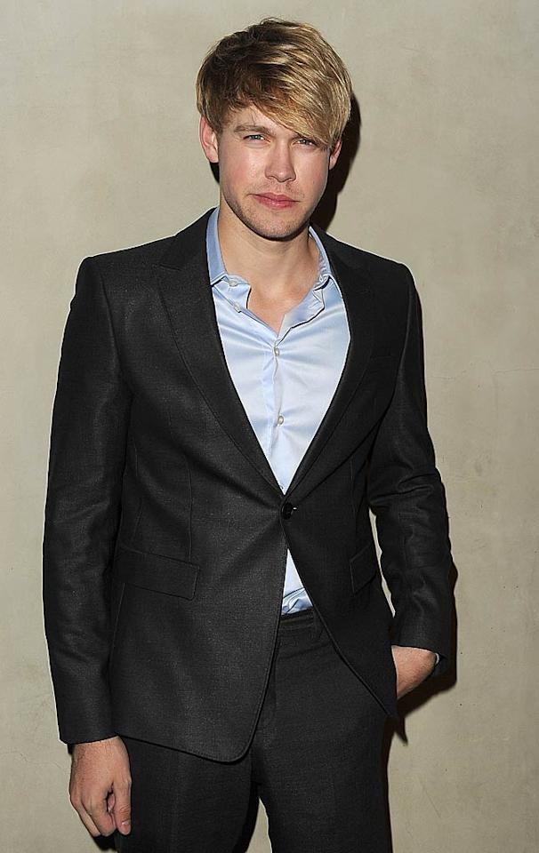 """Glee"" guy Chord Overstreet struck a pose in a dark, dapper suit.   Jason Merritt/GettyImages.com - October 11, 2011"