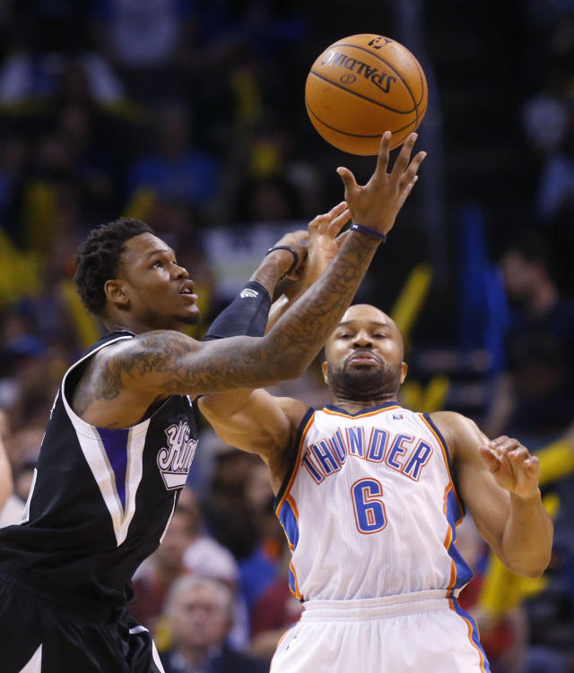 Sacramento Kings guard Ben McLemore (16) reaches for the ball in front of Oklahoma City Thunder guard Derek Fisher (6) in the fourth quarter of an NBA basketball game in Oklahoma City, Sunday, Jan. 19, 2014. Oklahoma City won 108-93. (AP Photo/Sue Ogrocki)