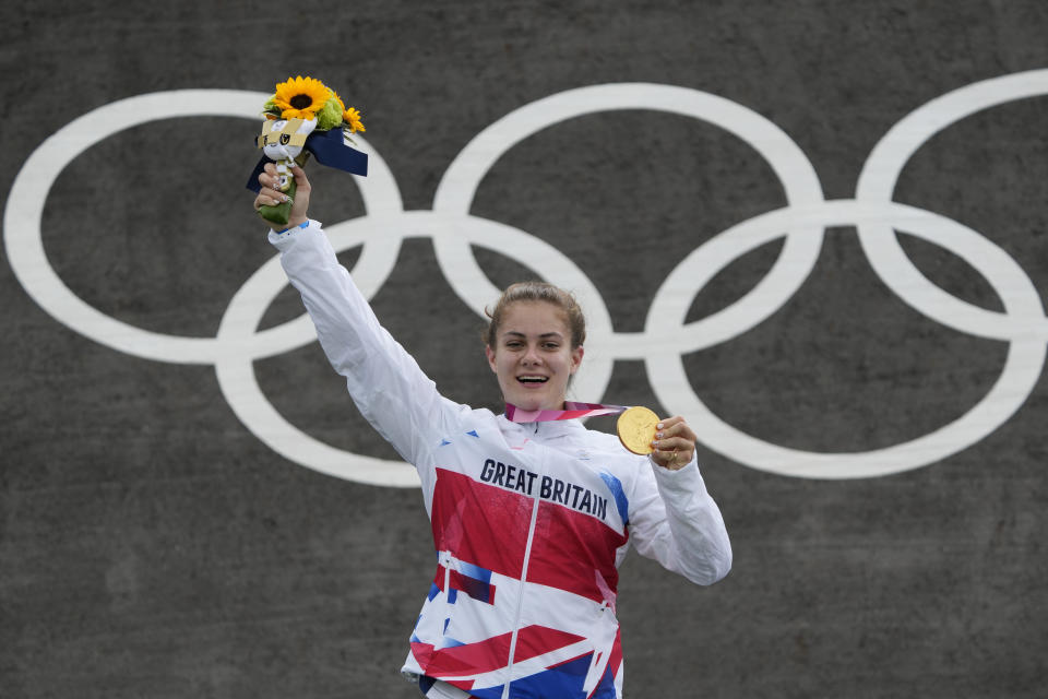 Bethany Shriever of Britain stands with her gold medal in the women's BMX Racing finals at the 2020 Summer Olympics, Friday, July 30, 2021, in Tokyo, Japan. (AP Photo/Ben Curtis)