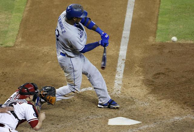 Los Angeles Dodgers' Hanley Ramirez, right, connects for a home run as Arizona Diamondbacks' Miguel Montero looks on in the seventh inning of a baseball game on Thursday, Sept. 19, 2013, in Phoenix. (AP Photo/Ross D. Franklin)