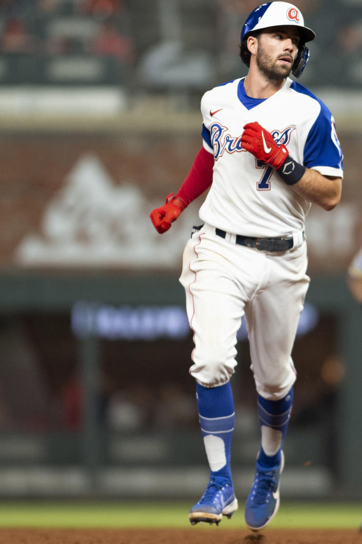 Atlanta Braves' Dansby Swanson (7) rounds second base after hitting a two-run home run against the Milwaukee Brewers during the sixth inning of a baseball game Saturday, July 31, 2021, in Atlanta. (AP Photo/Hakim Wright Sr.)