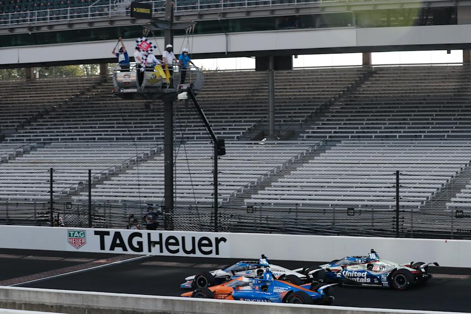 <em>Race winner Takuma Sato takes the checkered flag of the 104th Indy 500 ahead of Scott Dixon and Graham Rahal Joe Skibinski/IndyCar).</em>