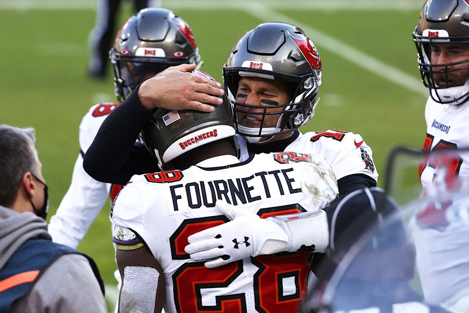 Leonard Fournette celebrates with Tom Brady of the Tampa Bay Buccaneers after scoring a touchdown in the second quarter of the NFC championship game. (Photo by Dylan Buell/Getty Images)