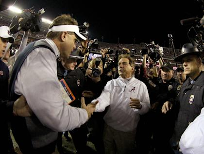 Alabama's Nick Saban and Auburn's Gus Malzahn shake hands after the Crimson Tide's win. (USAT)