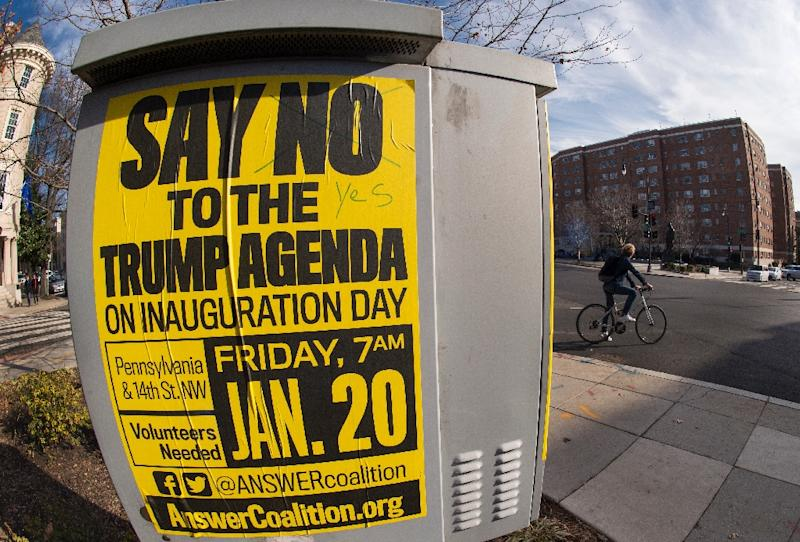 Street posters calling for protests are seen  in the Dupont Circle area of Washington, DC, a week before the Inauguration of Donald Trump as US president
