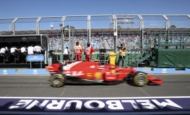 A Ferrari drives down pit lane during the first practice session at the Australian Formula One Grand Prix in Melbourne, Friday, March 23, 2018. The first race of the 2018 seasons is on Sunday. (AP Photo/Rick Rycroft)