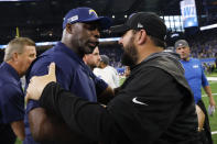 Los Angeles Chargers head coach Anthony Lynn, left, and Detroit Lions head coach Matt Patricia talk after an NFL football game in Detroit, Sunday, Sept. 15, 2019. Detroit won 13-10. (AP Photo/Rick Osentoski)