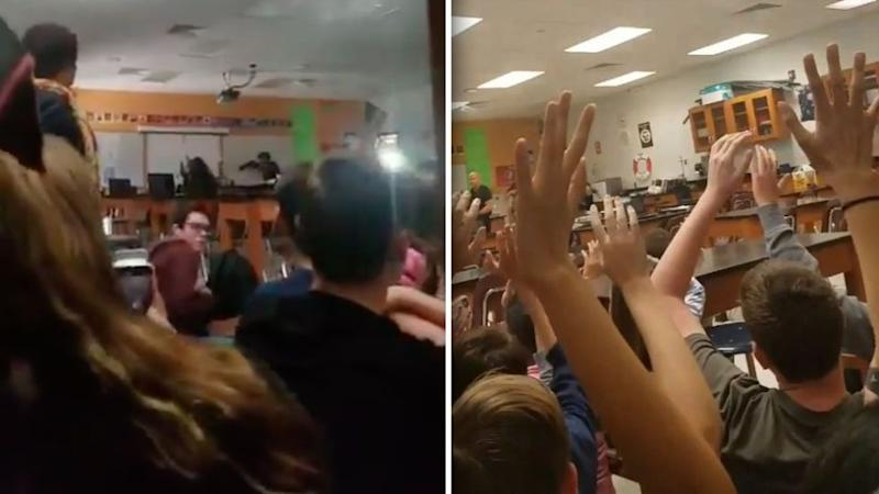 Trembling students raise their hands above their heads as SWAT officers storm the classroom. Source: Twitter/Melody Ball