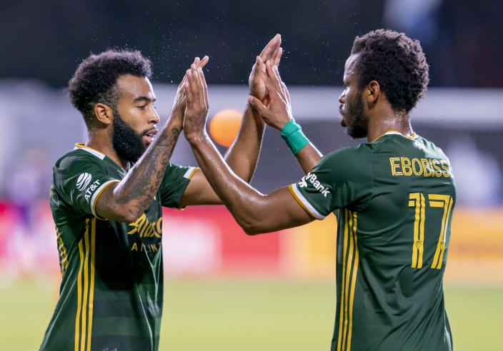 The play of Eryk Williamson (left) and Jeremy Ebobisse has helped propel the Portland Timbers into the semifinals of the MLS is Back Tournament. (Andrew Bershaw/Getty Images)