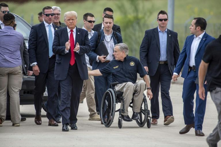 Former US president Donald Trump was accompanied by Texas Governor Greg Abbott (C) for a visit to a section of the border wall near Pharr, Texas