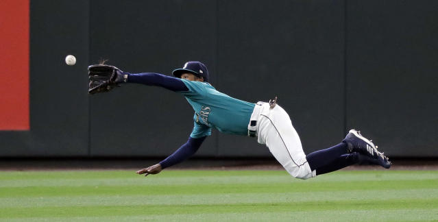 Seattle Mariners left fielder Mallex Smith and catches a sacrifice fly by Houston Astros' Tony Kemp during the eighth inning of a baseball game Thursday, June 6, 2019, in Seattle. (AP Photo/Elaine Thompson)