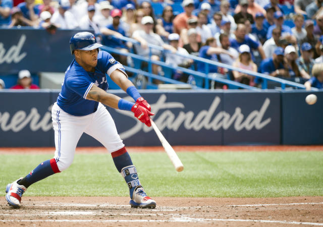 Toronto Blue Jays third baseman Yangervis Solarte hits an RBI single against the Atlanta Braves during the seventh inning of a baseball game in Toronto, Wednesday, June 20, 2018. (Nathan Denette/The Canadian Press via AP)