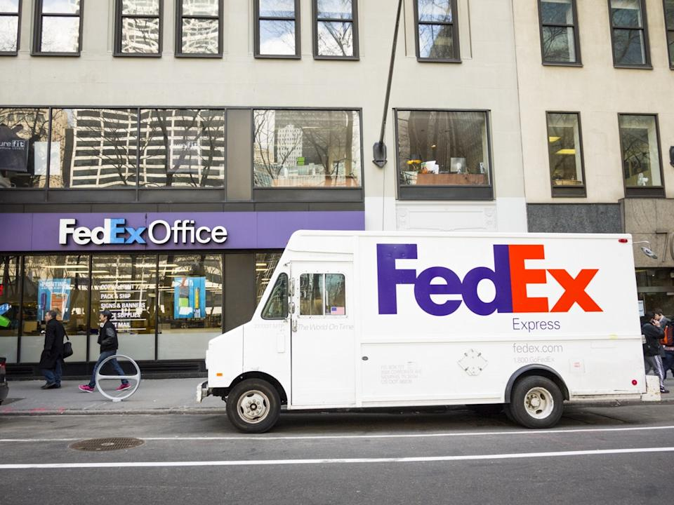 New York, New York, USA - March 13, 2013: A parked FedEx Express truck in midtown Manhattan in front of a Fedex Office store in the afternoon. FedEx is one of the leading package delivery services offering many different delivery options. Fedex Office stores act as a shipping depot as well as office supply and service stores. People can be seen on the street. [url=/my_lightbox_contents.php?lightboxID=3623142]Click here for more[/url] New York images and video.
