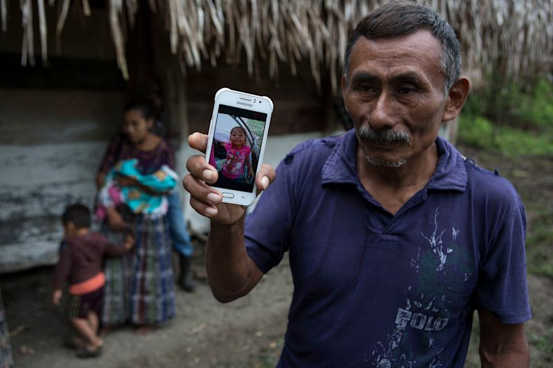 Domingo Caal Chub, 61, displays a photo of his granddaughter, Jakelin Amei Rosmery Caal Maquin