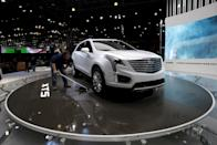 A worker prepares the Cadillac exhibit area ahead of the New York International Auto Show at the Jacob Javits Convention Center in New York, March 22, 2016. REUTERS/Mike Segar