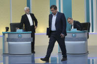 """In this picture made available by Young Journalists Club, YJC, presidential candidates for June 18, elections Saeed Jalili, left, Abdolnasser Hemmati, center, and Alireza Zakani, conclude a part of the final debate of the candidates at a state-run TV studio in Tehran, Iran, Saturday, June 12, 2021. Iran's seven presidential candidates offered starkly different views Saturday in the country's final debate, with hard-liners describing those seeking ties with the West as """"infiltrators"""" and the race's sole moderate warning a hard-line government would only bring more sanctions for the Islamic Republic. (Morteza Fakhri Nezhad/ Young Journalists Club, YJC via AP)"""
