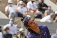 Italy's Lorenzo Musetti reacts after missing a point as he plays against Serbia's Novak Djokovic during their fourth round match on day 9, of the French Open tennis tournament at Roland Garros in Paris, France, Monday, June 7, 2021. (AP Photo/Michel Euler)