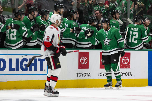 Dallas Stars center Joe Pavelski (16) is congratulated by teammates after scoring a goal during the second period of an NHL hockey game against the Ottawa Senators in Dallas, Monday, Oct. 21, 2019. (AP Photo/Sam Hodde)