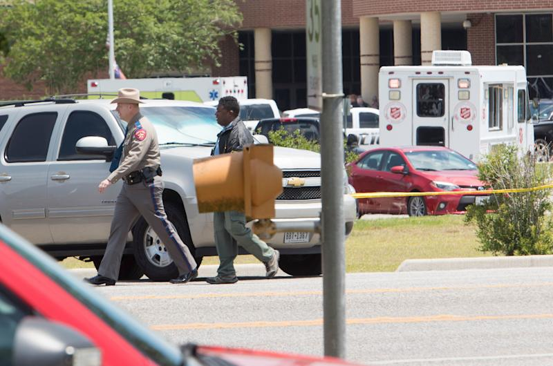 Emergency crews and police gather in the parking lot of Santa Fe High School.