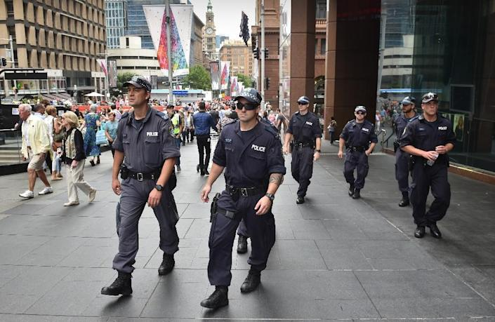 Police patrol outside the Lindt cafe, the scene of a fatal siege in the heart of Sydney's financial district, on December 18, 2014 (AFP Photo/Peter Parks)