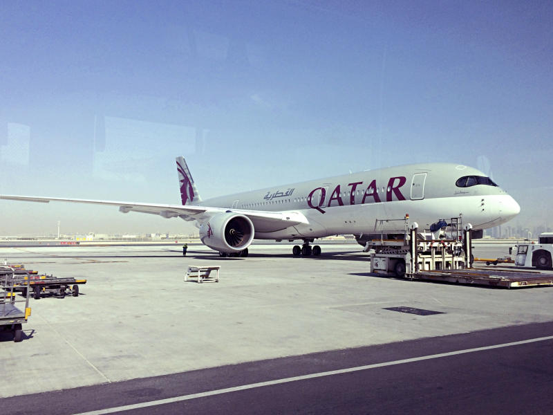 FILE - This June 6, 2017, file photo shows a parked Qatari plane in Hamad International Airport in Doha, Qatar. The United Arab Emirates orchestrated the hacking of a Qatari government news site in May, planting a false story that was used as a pretext for the current crisis between Qatar and several Arab countries, according to a report Sunday, July 16, by The Washington Post. In early June, Saudi Arabia, the United Arab Emirates, Bahrain and Egypt cut ties with Qatar and moved to isolate the small, but wealthy Gulf nation, canceling air routes between their capitals and Qatar's and closing their airspace to Qatari flights. (AP Photo/Hadi Mizban, File)