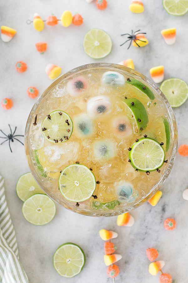 """<p>If you prefer to satisfy your sweet tooth with candy and other treats, this lemongrass tea-based punch is a great, not-too-sweet option! The spooky ice cube gummies and candy skewers are perfect garnishes for this party punch. <strong><br></strong></p><p><strong>Get the recipe at <a href=""""https://sugarandcharm.com/monster-mash-lemongrass-party-punch"""" rel=""""nofollow noopener"""" target=""""_blank"""" data-ylk=""""slk:Sugar and Charm"""" class=""""link rapid-noclick-resp"""">Sugar and Charm</a>. </strong></p><p><a class=""""link rapid-noclick-resp"""" href=""""https://www.amazon.com/CSBD-Gallon-Premium-Quality-Plastic/dp/B07MZBBRYF/?tag=syn-yahoo-20&ascsubtag=%5Bartid%7C2164.g.36792938%5Bsrc%7Cyahoo-us"""" rel=""""nofollow noopener"""" target=""""_blank"""" data-ylk=""""slk:SHOP PUNCH BOWLS"""">SHOP PUNCH BOWLS</a></p>"""