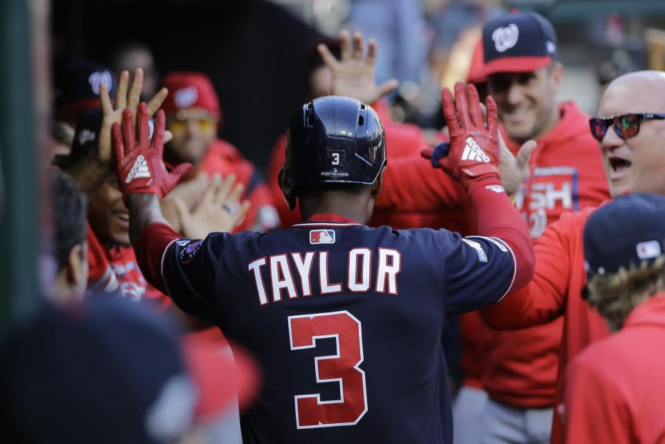 Washington Nationals' Michael A. Taylor is congratulated after hitting a home run during the third inning of Game 2 of the baseball National League Championship Series against the St. Louis Cardinals Saturday, Oct. 12, 2019, in St. Louis. (AP Photo/Mark Humphrey)
