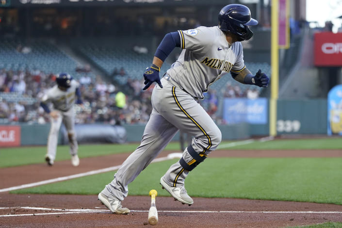 Milwaukee Brewers' Omar Narvaez runs to first base after hitting an RBI-single against the San Francisco Giants during the first inning of a baseball game in San Francisco, Monday, Aug. 30, 2021. (AP Photo/Jeff Chiu)