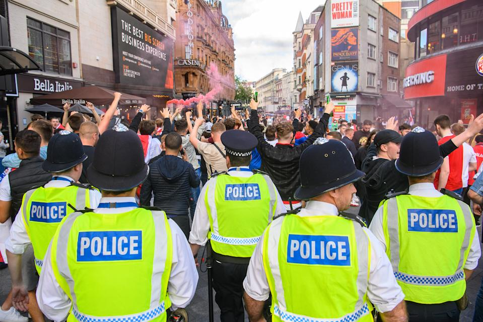 England gather in Leicester Square, London, before England play Ukraine in the UEFA Euro 2020 Quarter Final. (Matt Crossick/Empics)