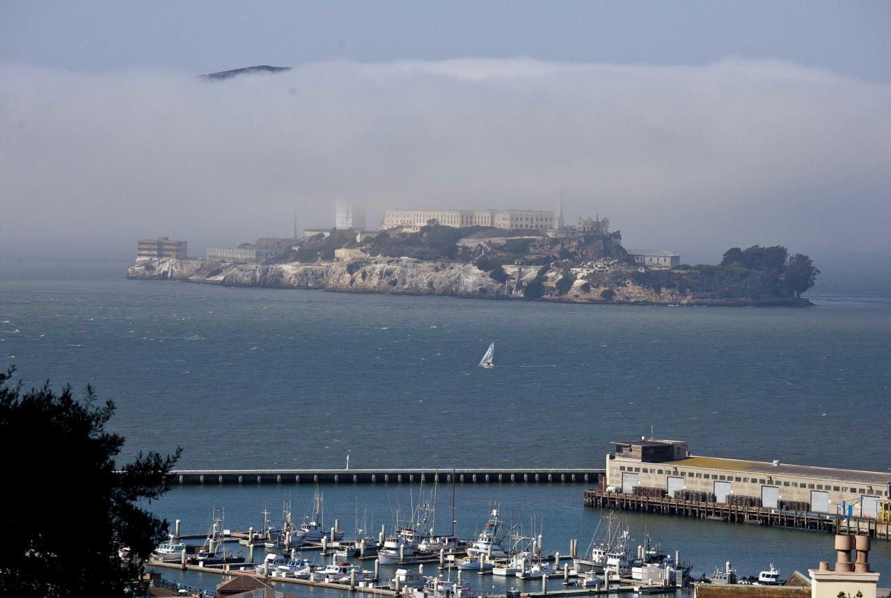 "In this photo taken Thursday, Sept. 27, 2012, a sailboat makes its way past Alcatraz Island in San Francisco. San Francisco has a long history as a favorite site for filmmakers and the movie buffs who want to see the spots where their favorite scenes took place, from Fort Point under the Golden Gate Bridge where Jimmy Stewart saved Kim Novak in ""Vertigo"" to the steps of City Hall, where Sean Penn gave an impassioned speech in ""Milk,"" to Alcatraz, stage for Clint Eastwood and many others. (AP Photo/Eric Risberg)"