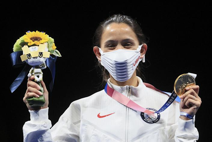 Gold medallist Lee Kiefer of the United States poses at a victory ceremony for the women's foil fencing (Sergei Bobylev / TASS / Getty Images)